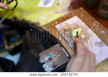 Jeweler Working On Ring