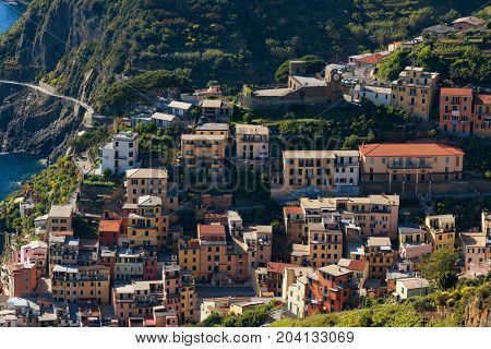 MANAROLA, ITALY - MAY 24, 2017: Magnificent daily view of the Manarola village in a sunny summer day. Manarola is one of the five famous villages in Cinque Terre (Five lands) National Park.