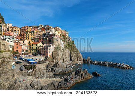 MANAROLA, ITALY - MAY 24, 2017: Magnificent daily view of the Manarola village in a sunny summer day. Manarola is one of the five famous villages in Cinque Terre (Five lands) National Park. Liguria, Italy, Europe