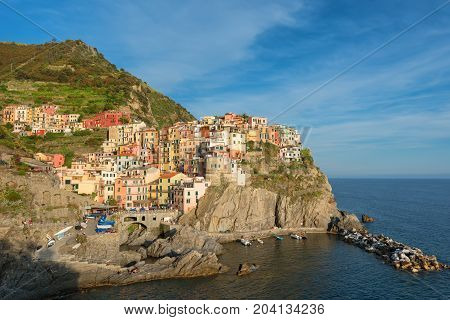 Magnificent daily view of the Manarola village in a sunny summer day. Manarola is one of the five famous villages in Cinque Terre (Five lands) National Park. Liguria, Italy, Europe