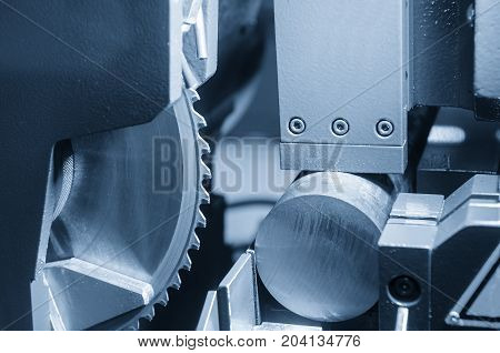 The industrial saw for cutting the metal rod in light blue scene.The industrial tool.