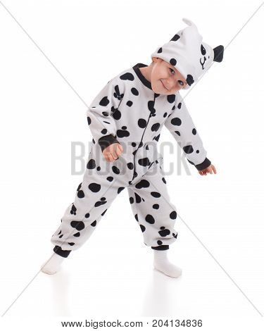 Little boy dressed in a Dalmatian suit.Plum Pudding Dog