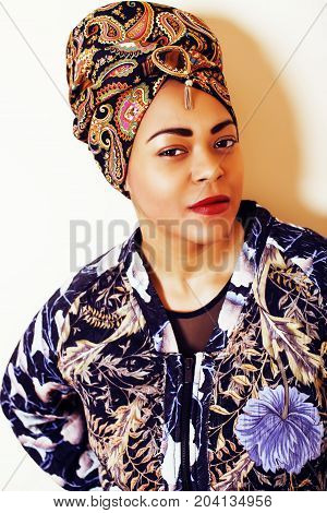 beauty bright african woman with creative make up, shawl on head like cubian closeup smiling, cheerful tan mulatto, lifestyle people concept close up