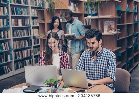 Couples Of International Teens Are Studying After Lectures In The Library, Smiling, Chatting, Enjoyi