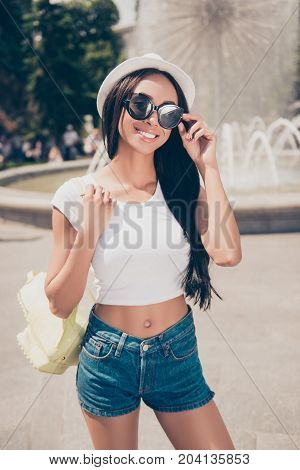 Attractive Carefree Gorgeous Mixed-race Lady With Bronze Skin Is Posing In Sunny Town, On Stroll, In