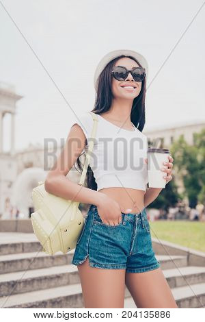 Attractive Carefree Gorgeous Mixed-race Lady With Bronze Skin Is On Stroll, In Trendy Eyewear, With