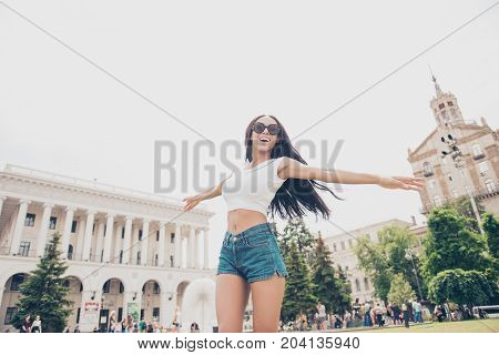Dream Big! Carefree Cute Student In Summer Hot Outfit Is So Happy, Jumping Outside While On Stroll I