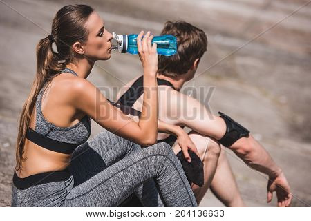 Sportive Couple Resting On Slabs