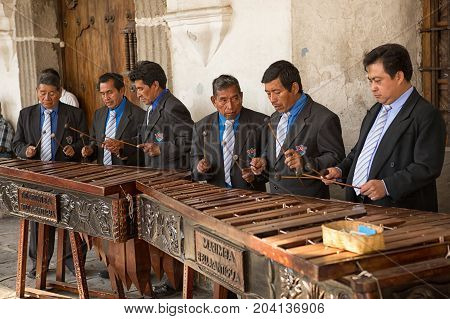 February 8 2015 Antigua Guatemala: men marimba band playing in front of a colonial building