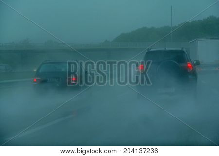 traffic on the freeway a rainy day
