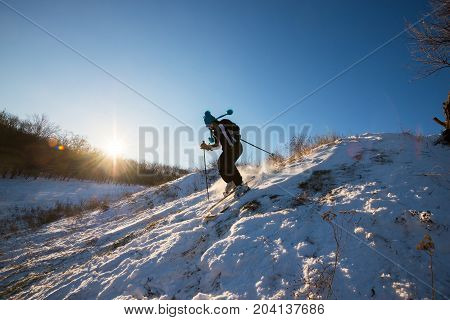 Girl Skier In Funny Cap Fast Rides Downhill