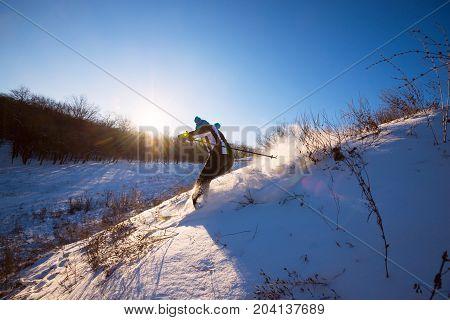 Skier Fast Rides Downhill