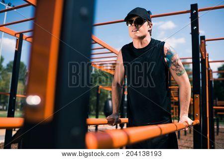 Man Exercising On Sports Ground