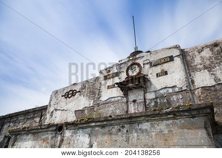 Facade Of Old Abandoned Fortification From Wwii