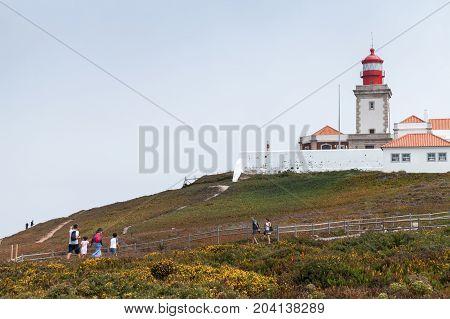 Tourists Walk Near Lighthouse Cabo Da Roca