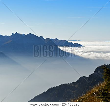 Autumn mist hovering over the Rhone valley at the foot of the French Alps Leysin Vaud Switzerland