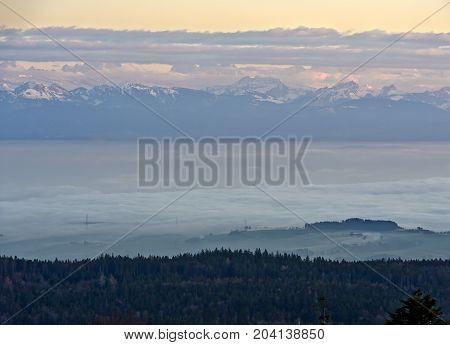 Autumn fog above Lake Geneva French Alps behind Nyon Switzerland