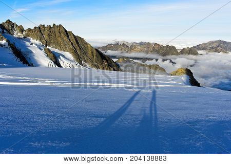 Long shadows of two persons on a Glacier Chamonix Haute-Savoie France