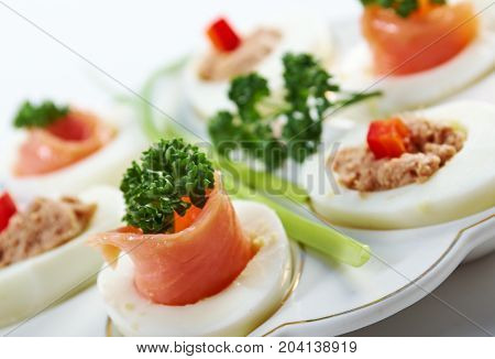 stuffed eggs with salmon and pate , close up