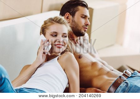 Young Couple With Smartphone