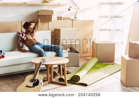 Shirtless Man Moving In New House