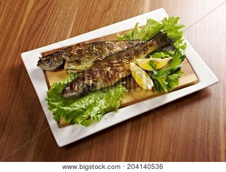Two grilled Rainbow Trouts.Served with Vegetables , close up