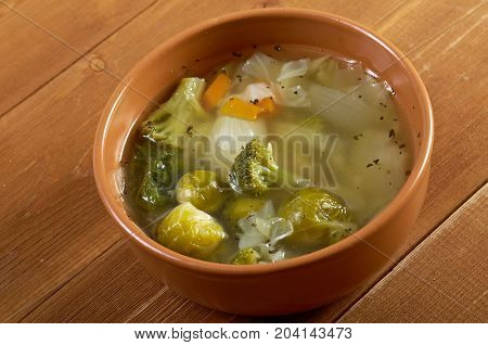 italian farm-style soup mixture of cabbage  , close up traditional meal