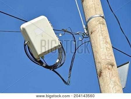 Internet switch and cables on a pole outdoors