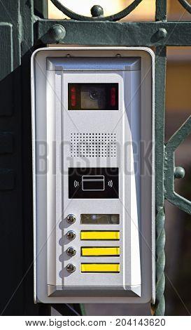 Intercom on the metal door outdoor at