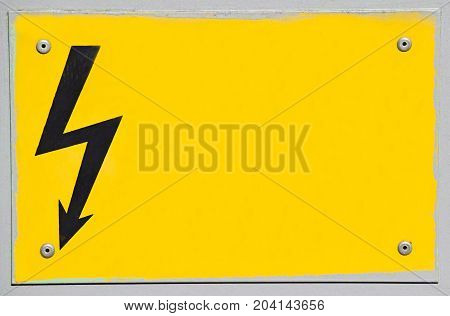 High voltage electricity sign on yellow background