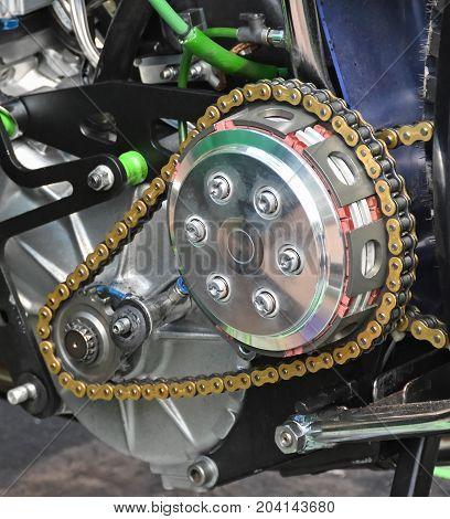 Chain part of a motorcycle closeup in day time