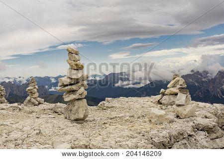 Stone mounds on top of Sass Pordoi. Dolomites. Italy.