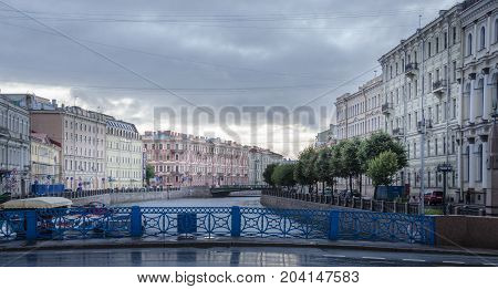 19TH SEPTEMBER 2012, ST PETERSBURG, RUSSIA - Moyka river blue bridge and embankment in St Petersburg Russia