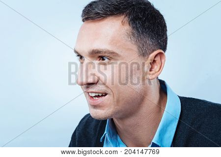 What is that. Scaled up look on a surprised man in casual looking at something attentively with his eyes and mouth wide opened.