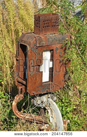 Old rusty railway switch in the grass