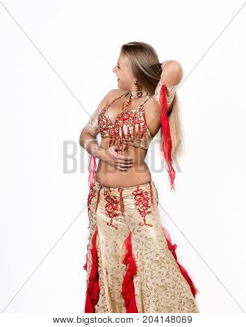 Arabic dance performed by a beautiful plump woman on a light background.