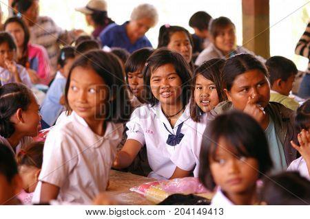 Prachinburi Province Thailand - November 28 2009: Happy Thai rural teenager girls with their parent at remote area school.