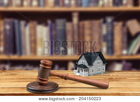Model wooden house gavel background close-up paper