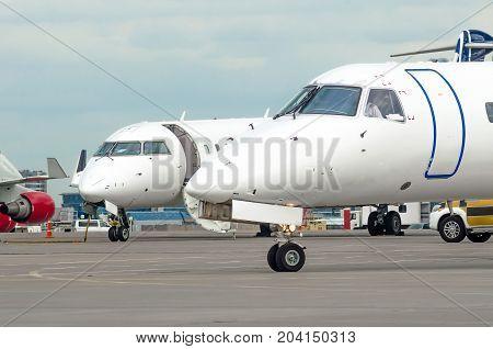 Pair Of Noses Cockpit Aircraft Pilots At The Airport