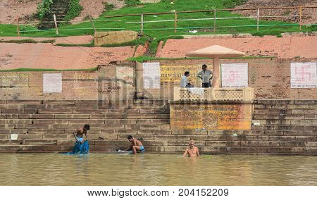 People Take Holy Bath In The Ganges River