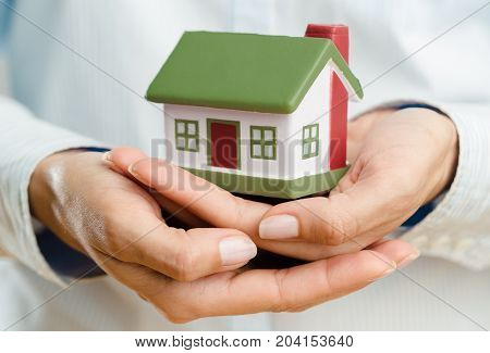 Holding model hands house closeup business human