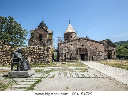 Armenia. The monastery complex Goshavank. Exterior with a monument to the founder of the monastery Mkhitar Gosh.