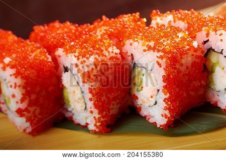 Roll Made Of Smoked Fish And Red Roe
