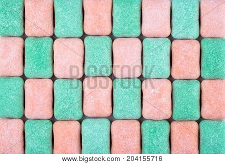 Colorful textured chewing gum background close up