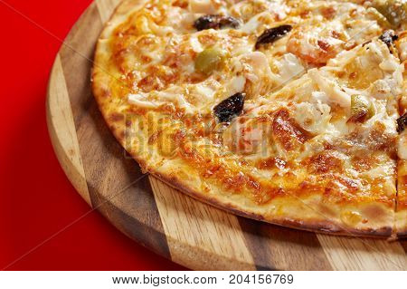 Pizzawith seafood. italian kitchen. Studio    close up traditional meal