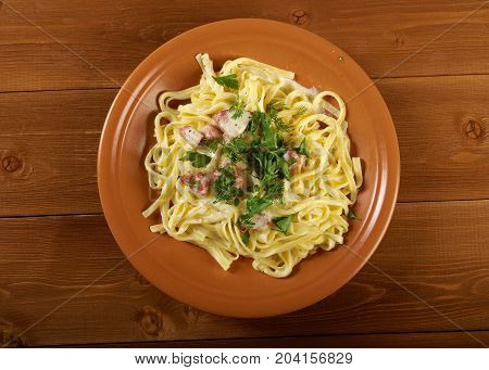 pasta Fettuccine Alfredo with sausage.  close up meal