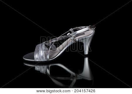 Portugal, June, 2017:Innovation Sandal Femme, Innovation, Multinational Company. Isolated on Black. Product shots.