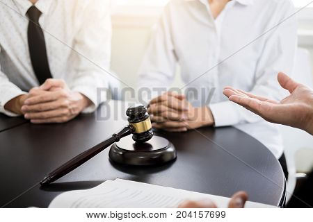 business people and lawyers discussing contract papers sitting at the table. Concepts of law advice legal services.