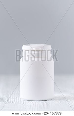 mock up plastic bottle for medicine, powder, pills, tabs, capsules on gray background