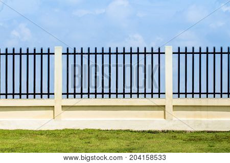 beautiful of fence factory in industrial estategreen field and stone with blue sky and cloud as background